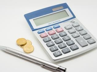 Calculator, Coins and Pen