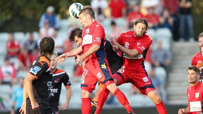 Adelaide United's Jeronimo gets above teammate Jon McKain (right) to head towards goal. Picture: Sarah Reed