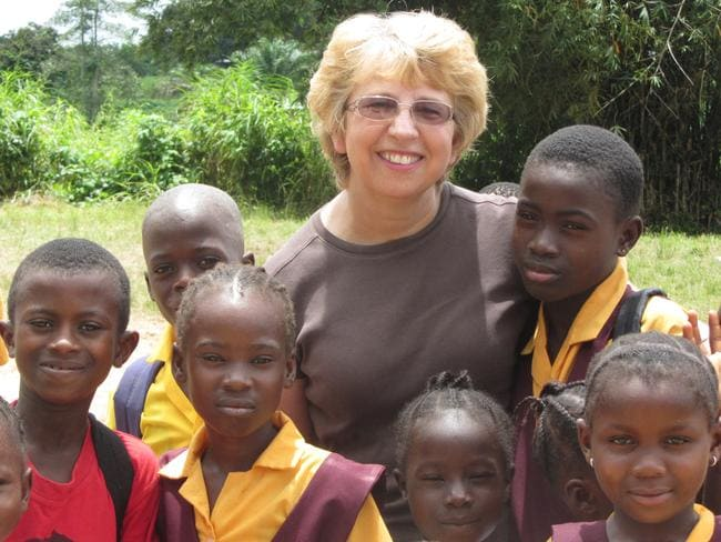 Fighting for life ... Health worker Nancy Writebol with children in Liberia. Picture: Jeremy Writebol