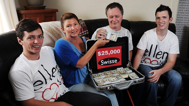 Brothers Julian Wilson, 19, and Dailius Wilson, 21, with their dad Mark Wilson who is recovering from surgery for a brain tumor, and wife/mum Belinda Hornas. Ellen gave the boys a cheque for $25,000 for their dad's medical bills. Picture: Braden Fastier