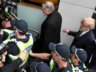 Cardinal George Pell escorted by police departs the Melbourne Magistrates Court in Melbourne, Wednesday, July 26, 2017. Australia's most senior Catholic, Cardinal George Pell has made his first court appearance as he fights historical sexual offence charges. (AAP Image/Joe Castro) NO ARCHIVING