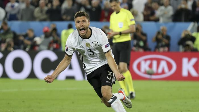 Germany's Jonas Hector celebrates after scoring the winning penalty.