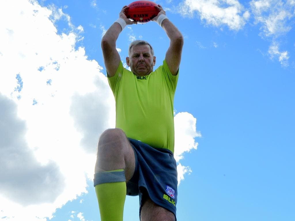 <s1>  Umpire Mike Horsman, 71, started officiating in country and suburban footy games in 1961.  </s1>  <s1>  Picture: BERNARD HUMPHREYS </s1>