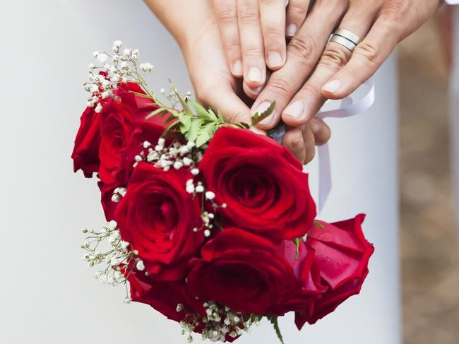 red roses, wedding rings, white suit and gown, wedding setting, bouquet of roses, close up marriage act for paul syvret