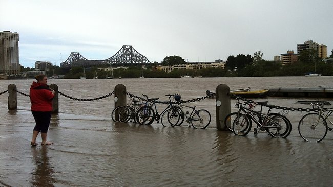 The Brisbane CBD suffered extensive damage from high winds and flooding linked to ex-tropical cyclone Oswald.