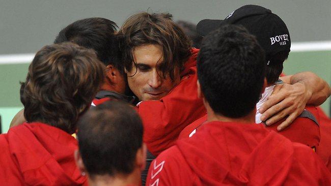 David Ferrer celebrates with his Spanish teammates after defeating Radek Stepanek.