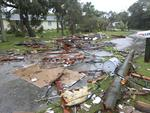Debris from a second story roof is scattered over a two-block area after a possible tornado touched down at Palm Bay Point subdivision Sunday, Sept. 10, 2017, in Palm Bay, Florida. Picture: Red Huber/Orlando Sentinel via AP