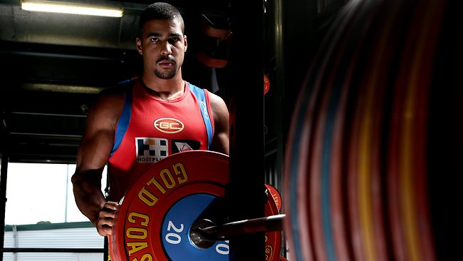 SPORT - Gold Coast Suns player Joel Wilkinson set a new bench press record for the club. He lifted 160kgs. Pic by Luke Marsden. Picture: Luke Marsden
