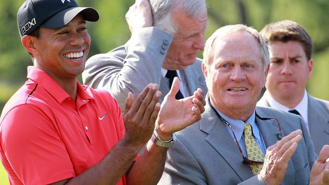 Tiger Woods shares a laugh with Jack Nicklaus in 2012.