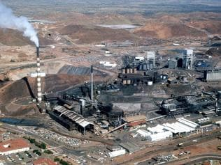 News/property 18/3/1977 Mt Isa Mine. Mount Isa ,dominated by the chimney of the mine, is more than just a copper city to the people of the north. With Cairns,it is their main link with cities and the comforts they provide. Neg no CT-R-18562. Picture by -------. The Courier-Mail Photo Archive. Scanned January 2012.