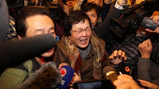 Immense grief ... a relative of a passenger onboard MH370 on March 8 in Beijing. Photo: Getty Images.