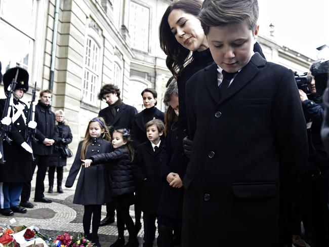 Princess Mary and her son, Prince Christian, view flowers in front of Amalienborg Palace. Picture: AP