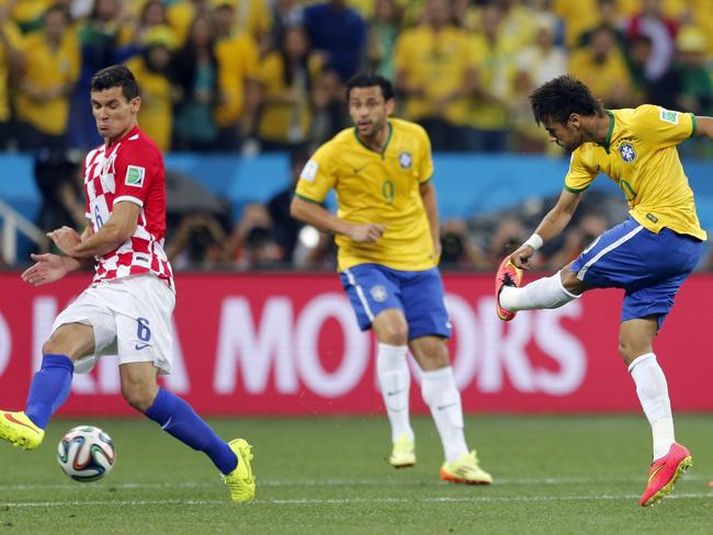 Brazil's Neymar, right, shoots from long range to score his side's first goal against Croatia.