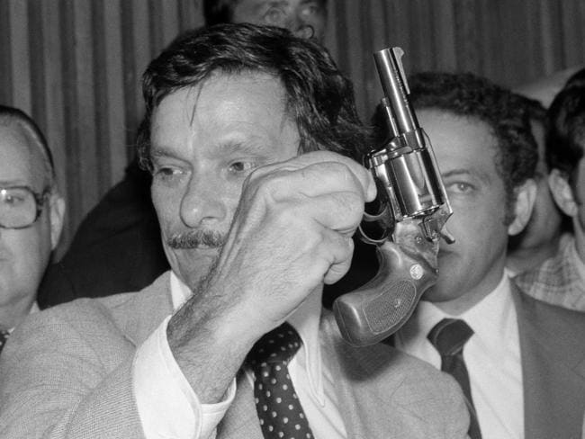 New York City police officer Edward Zigo displays a .44-calibre revolver at a news conference, early in the morning after the arrest of David Berkowitz in 1977. Picture: AP Photo/Ira Schwarz