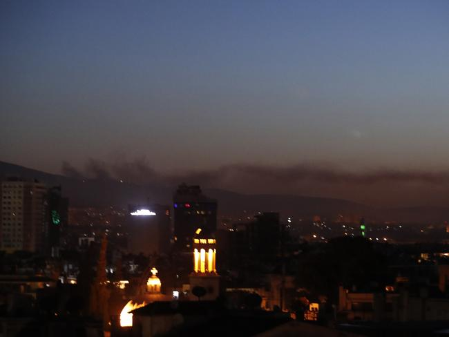 Smoke rises after air strikes targeting different parts of the Syrian capital Damascus, Syria. Picture: AP