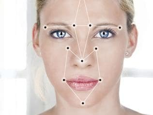 Face detection software recognizing a face of beautiful young woman