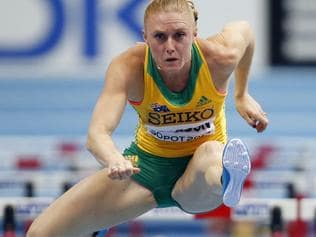 FILE - In this March 8, 2014 file photo, Australia's Sally Pearson clears a hurdle in her 60m hurdles semi-final during the Athletics World Indoor Championships in Sopot, Poland. Hurdles gold medalist Pearson has reportedly withdrawn from the Olympics in Rio de Janeiro because of a hamstring injury. (AP Photo/Petr David Josek, File)