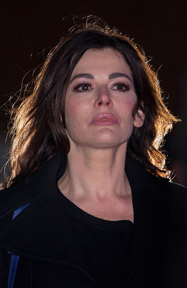 British television chef Nigella Lawson leaves Isleworth Crown Court in west London after giving evidence in the case in which her two personal assistants (Elisabetta and Francesca Grillo) were accused of defrauding her and former husband Charles Saatchi. . AFP /CARL COURT