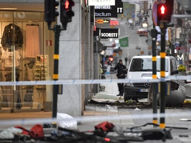 A police officer stands at the cordoned off area following a terror attack on Drottninggatan Street in central Stockholm. Picture: AP