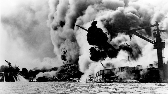 DECEMBER 7, 1941 : USS Arizona in flames after being hit during 07/12/41 Japanese attack on Pearl Harbour in Hawaii.