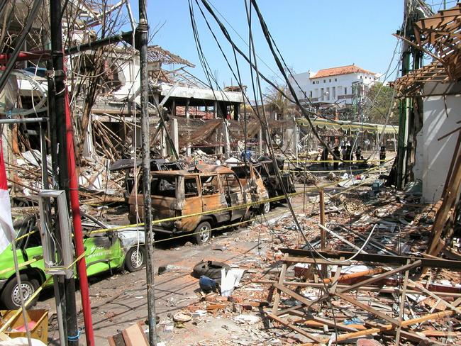 Bali bombings ... Investigators sift for clues in the bomb crater under a canopy outside the devastated Sari Club, in Legian St, Kuta. Picture: News Corp Australia
