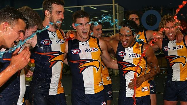 Dom Sheed, Xavier Ellis, Eric Mackenzie, Elliot Yeo and Jamie Bennell of the Eagles celebrate after winning Round 1. Photo by Paul Kane