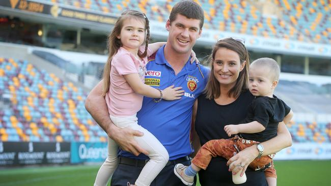 A series of head knocks forced Jonathan Brown, seen here with daughter Olivia, wife Kylie and son Jack, to hang up the boots early. Picture: Jono Searle