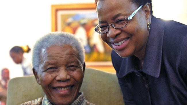 """A handout photo provided on May 16, 2011 by the South African government shows former South African President Nelson Mandela (L) posing with his wife Graca Machel on May 16 after casting his vote at his home in Johannesburg in a special arrangement for the infirm for this week's local elections. Ailing Nelson Mandela was on December 25, 2012 visited in hospital by his wife Graca Machel and family as he spent Christmas Day on sickbed, said President Jacob Zuma who joined the family. RESTRICTED TO EDITORIAL USE - MANDATORY CREDIT """"AFP PHOTO / SOUTH AFRICAN GOVERNMENT/ ELMOND JIYANE"""" - NO MARKETING NO ADVERTISING CAMPAIGNS - DISTRIBUTED AS A SERVICE TO CLIENTS"""