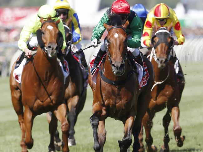 Turn Me Loose and jockey Kerrin McEvoy (red cap) take out the Group 1 Emirates Stakes. Picture: Michael Klein