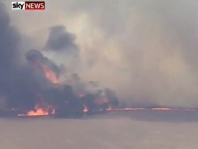 Home under threat ... bushfires force locals to flee. Picture: Sky News