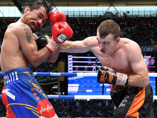Jeff Horn of Australia (right) strikes Manny Pacquiao of the Phillipines.