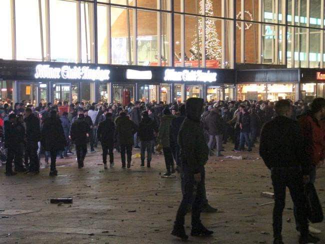 New Year's Eve ... a crowd gathers at the front of the main station in Cologne, Germany. Picture: Markus Boehm/DPA via AP
