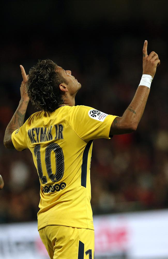 PSG's Neymar celebrates his side's third.