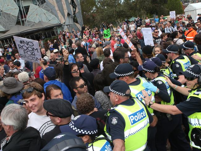 Police get between protesters 'Reclaim Australia' protesters at Federation Square.