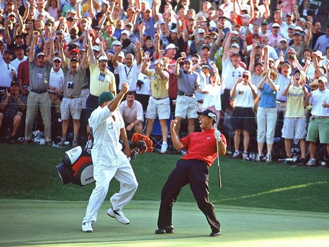 Woods celebrates his putt on the 16th.
