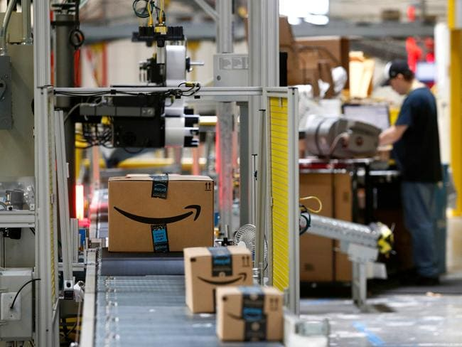 Packages pass through a scanner at an Amazon fulfilment centre. Picture: AP