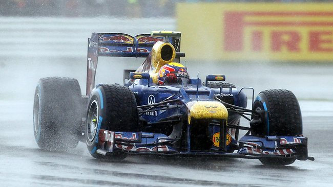 Red Bull Formula 1 car driver Sebastian Vettel, of Germany, drives his car in heavy rain during the qualifying session at the Silverstone circuit.