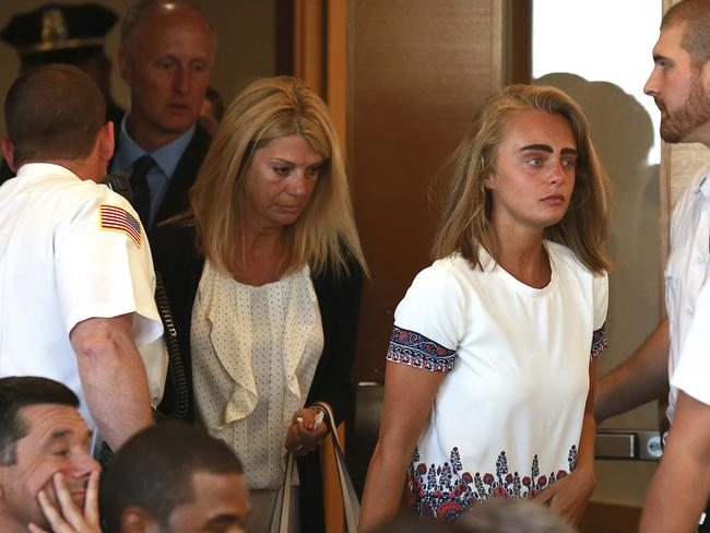 Michelle Carter with her parents in court, just prior to her sentencing. Picture: AP.