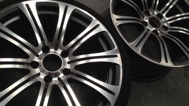 Spot the difference ... counterfeit BMW wheel (left) and the real deal (right). Picture: Joshua Dowling