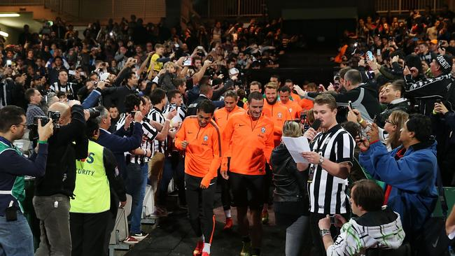 Fans greet the Juventus players as they head out onto the pitch for training on Saturday night.