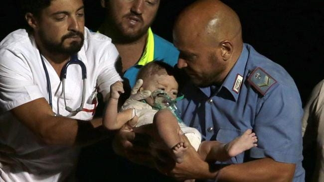 Cheers rang out as baby Pasquale was pulled from the rubble. Picture: ANSA via AP