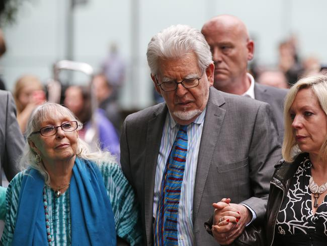 Shock....Harris, centre, accompanied by his daughter Bindi, right, and wife Alwen, leave the Southwark Crown Court in London after he was found guilty of 12 counts of indecent assault. Picture: AP