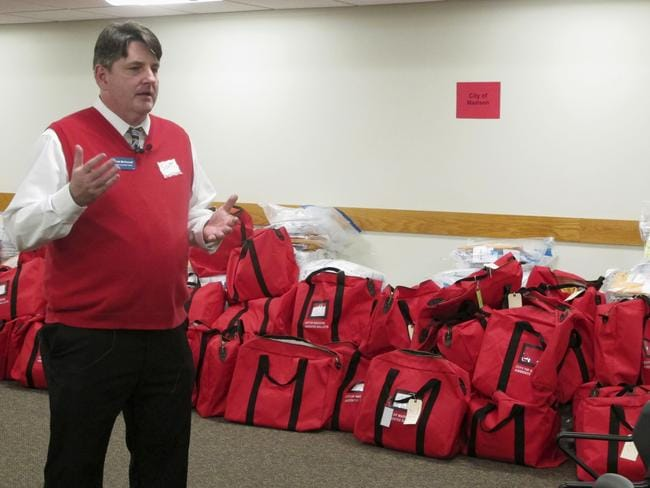 Dane County Clerk Scott McDonell stands in front of sealed bags of ballots before a recount of Wisconsin's presidential election results begins. Picture: AP