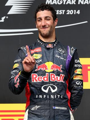 Daniel Ricciardo acknowledges a team member during the post-race ceremony. Picture: Getty Images
