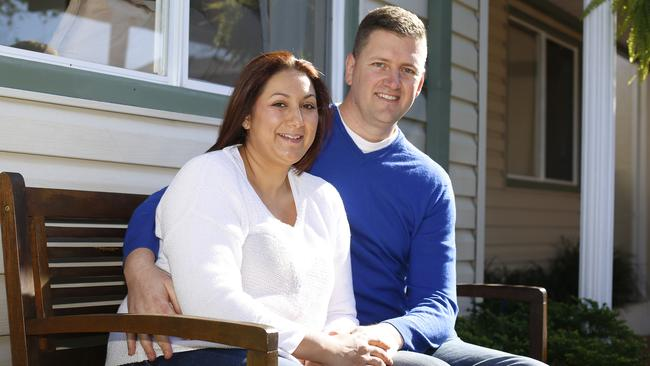 Chantal Snell and her husband Corey at their Pagewood home. Picture: David Moir.