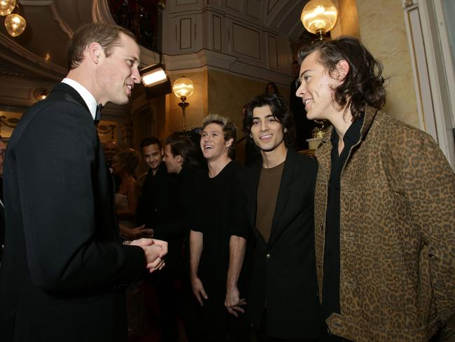 Royal touch...Prince William greets 1D after the Royal Variety Performance in London last week. Picture: Splash News