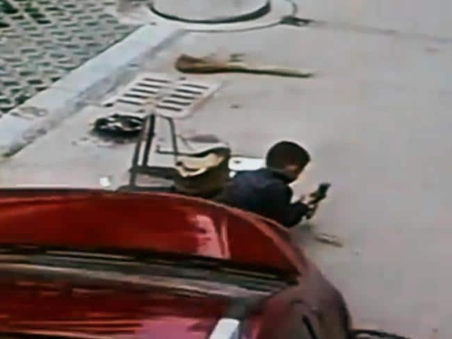 About to be run over by a SUV ... The six-year-old boy from Shandong Province is oblivious to the oncoming car. Picture: YouTube / via BBC