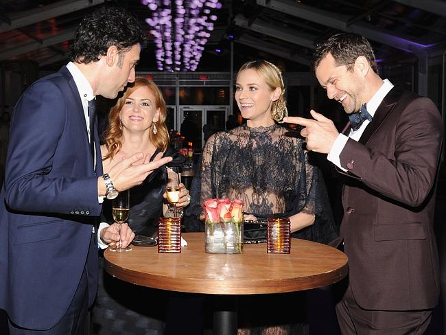 Isla Fisher with her husband Sacha Baron Cohen (left), Diane Kruger and Joshua Jackson share a drink and a laugh at the Vanity Fair Party. Picture: WireImage