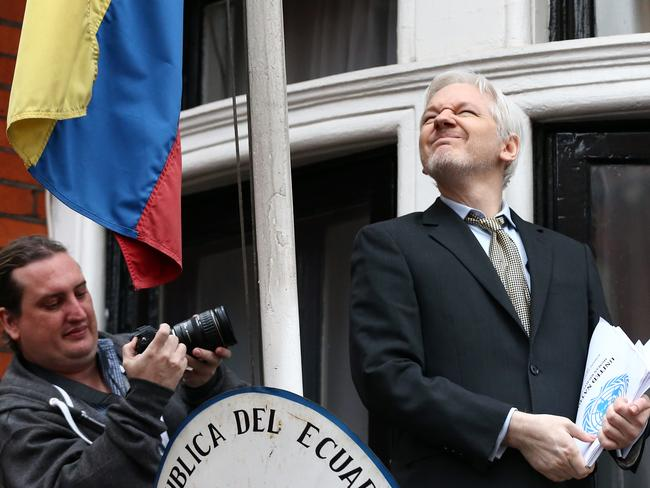 Detained ... Wikileaks founder Julian Assange squints in the sunlight as he speaks from the balcony of the Ecuadorean embassy. Picture: Carl Court/Getty Images