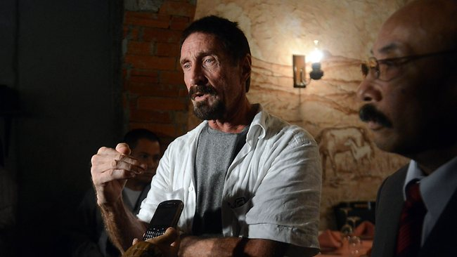 US anti-virus software pioneer John McAfee answers questions to a journalist next to his Guatemalan lawyer Telesforo Guerra, in a restaurant in Guatemala City.